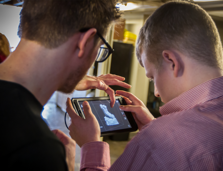 Photo of Brooks and Grant using mobile 3D scanning software