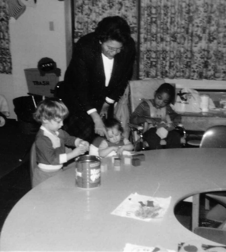 photo of Mary Ann Brown with kids in a classroom